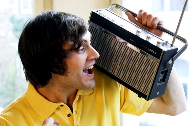 Enthusiastic Young Man Listening to Radio